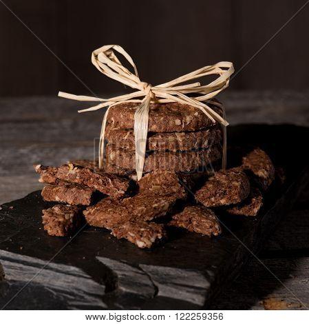 Stack Of Cereal Biscuits With Broken Pieces Around