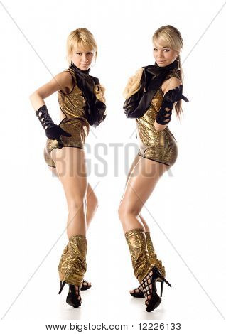 two beautiful dancer girl in gold costumes isolated