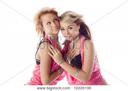 portrait of two attractive dancers in pink costumes isolated