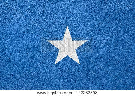 flag of Somalia or Somali banner on rough pattern background
