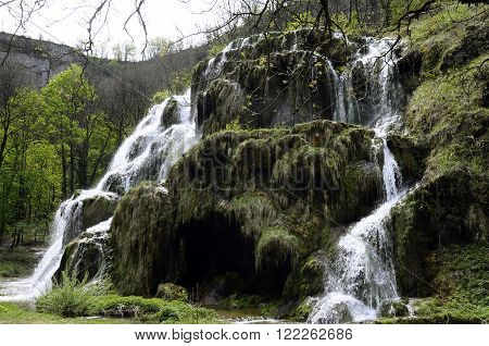 View of Baumes Les Messieurs waterfall in Jura France