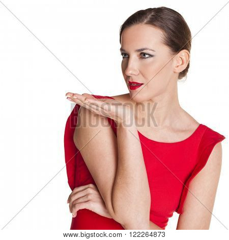 Young brunette woman in red dress blowing while sending an air kiss, isolated on white