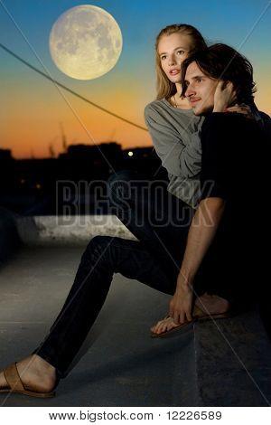 attractive couple in twilight under moon outdoor