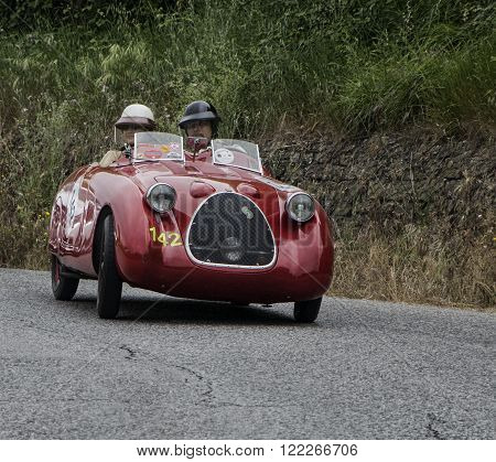 S.I.A.T.A. Pescara 1939 PESARO, ITALY - MAY 15: unidentified crew on an old racing car in rally Mille Miglia 2015 the famous italian historical race (1927-1957) on May 2015