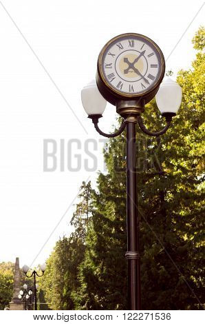 Street lamp with clock in a public park