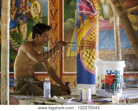 Cambodian Young Artist Paints A Temple Near Kampot.
