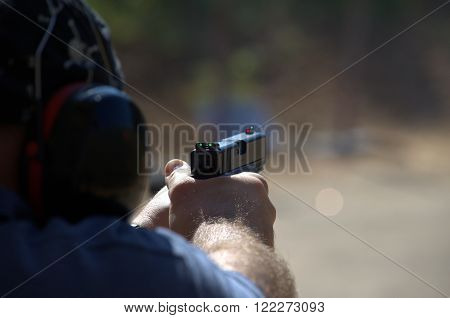 Handgun shooting training at the shooting range in Israel