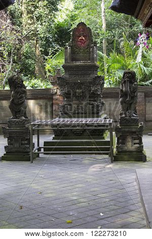 Ancient stone sculpture in the Balinese jungle Indonesia