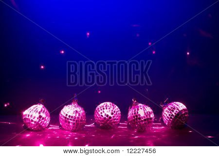 five purple disco balls reflection lights on blue background