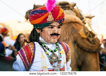 JAISALMER, INDIA - February 1 2015: Unidentified child with fake mustache and traditional rajput costume on the carnaval of Desert Festival on March 1, 2015. Every winter Jaisalmer takes famous Desert Festival