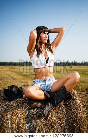 Young sexy woman in a cowboy hat.