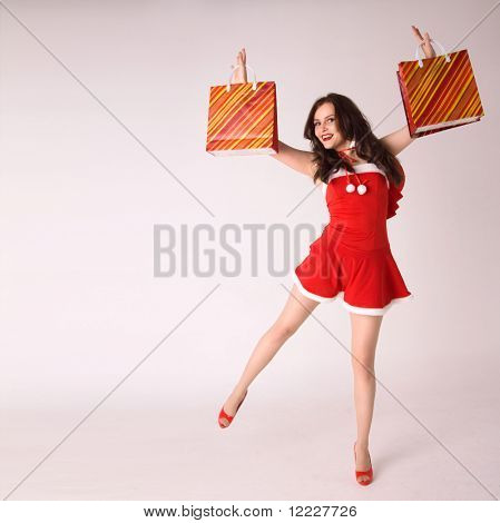 happy smiling woman shopping in red xmas sexy costume