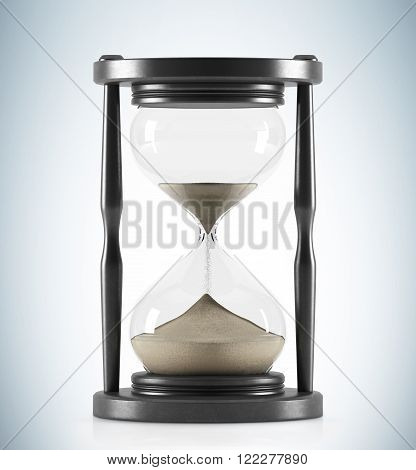 Sand glass in dark wooden carcass. Sand running. Concept of time. 3D rendering