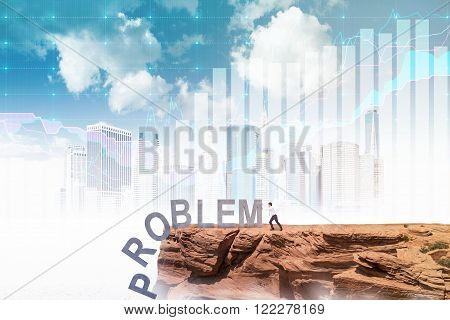 Businessman pushing letters of word 'problem' from rock. Blue sky New York and graphs at background. Concept of coping with problem.