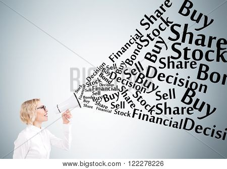 Businesswoman holding white loudspeaker many business words from it. Grey background. Concept of informing.