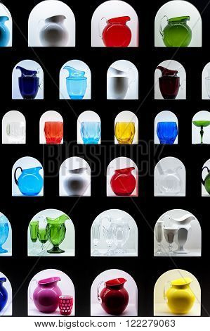 Colored carafes and glasses arranged on shelves and arches