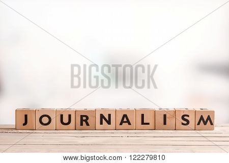 Journalism Sign On A Bright Table