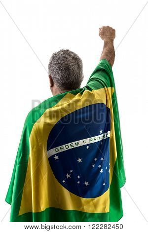Brazilian man holding the flag of Brazil on white background