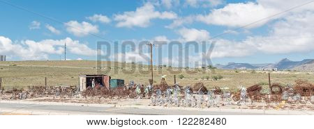 CRADOCK SOUTH AFRICA - FEBRUARY 19 2016: Wire-craft entrepeneurs selling windmills and other crafts outside Cradock a medium sized town in the Eastern Cape Province