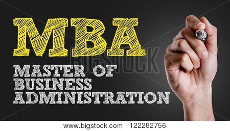Hand writing the text: MBA
