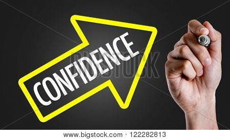 Hand writing the text: Confidence