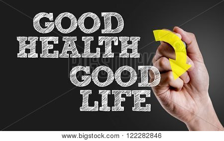 Hand writing the text: Good Health - Good Life