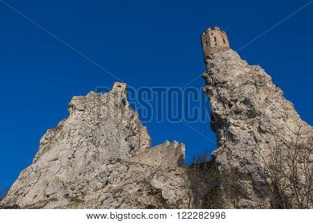Castle Devin built on the high rocks on the border of Slovakia and Austria. On the left famous Maiden Tower. Bright blue sky.