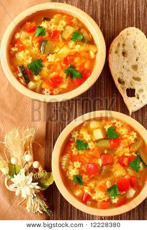 Delicious minestrone soup with bread