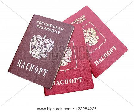Three passports of a citizen of Russian Federation isolated on white background. The inscriptions in Russian