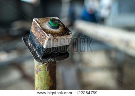 Sawmill. Image of machine power button, close-up