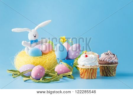 Colored  easter decoration with eggs and sweets