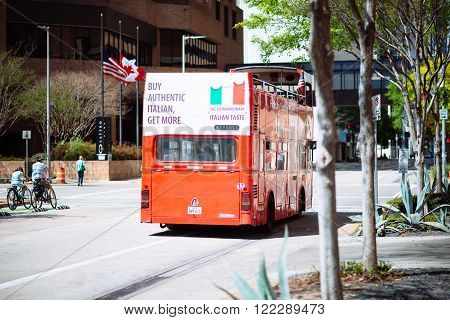 HOUSTON TEXAS - March 2016: Street scene in Houston Downtown with bouble deck red bus on sunny day on March 2016 in Houston United States. Buy authentic Itallian add on the bus.