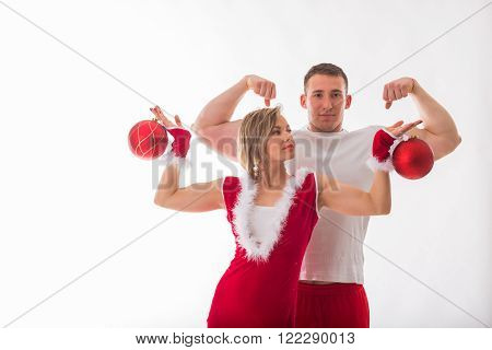 Sports man and woman posing on a white background. Athletic couple in sportswear, holding dumbbells. Fitness, sports, good shape, the pair - the concept of family fitness.