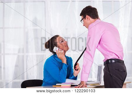 Young businesswoman at the hiring interview in the office.A woman manager looking at interview during conversation.Job interview.Job applicant having an interview