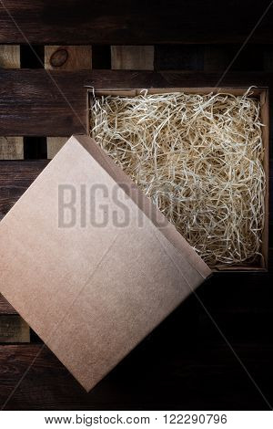 Hay in box on brown wooden pallet