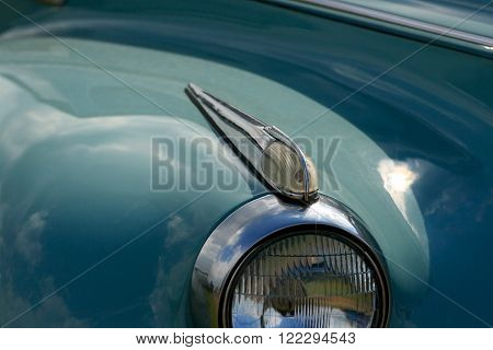 Closeup view of blinker and headlight of vintage car.