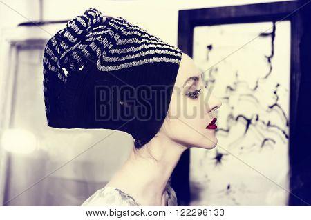Portrait of woman wearing headscarf retro style