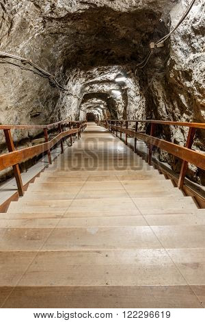 Wooden stairs going down in salt mine Praid Romania