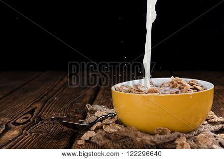 Pouring Milk On A Portion Of Cornflakes