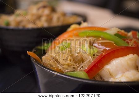 Typical Chinese food, chinese noodles with vegetables and prawns