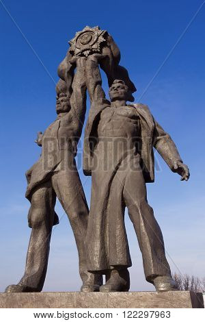 Kiev Ukraine - MARCH 8 2016: Monument depicting workers symbolizing the friendship between the Russian and Ukrainian peoples erected in 1982