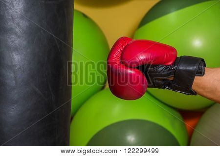 Muscular man in boxing gloves . Professional boxer boxing shows muscle in racks. Beautiful muscular body boxer. Photos for sporting magazines, posters and websites.