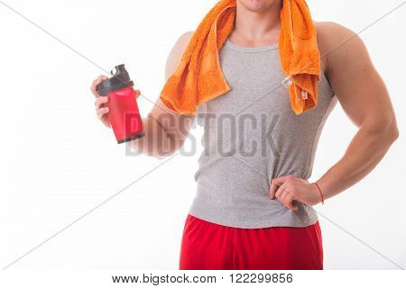 Man bodybuilder posing on white background Man is holding a shaker for drinks. Man drinking a protein shake, water, amino acids from the shaker. Sports, sports nutrition, food additive.