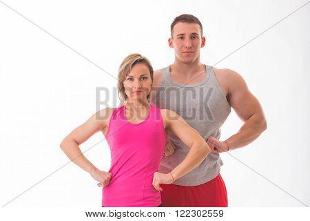 Sports man and woman posing on a white background. Athletic couple in sportswear. Fitness, sports, good shape, the pair - the concept of family fitness.