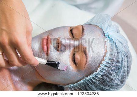 Beauty treatments in the beauty salon. Beautician revitalizing facial. Facial massage. Beauty, facial, beautician.