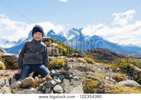 kid resting at mirador condor and enjoying hiking in torres del paine national park patagonia chile