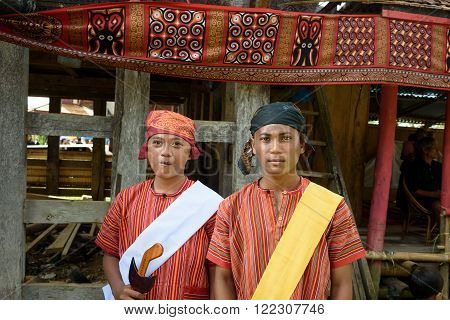 Boys In Traditional Clothes At Funeral Ceremony. Tana Toraja