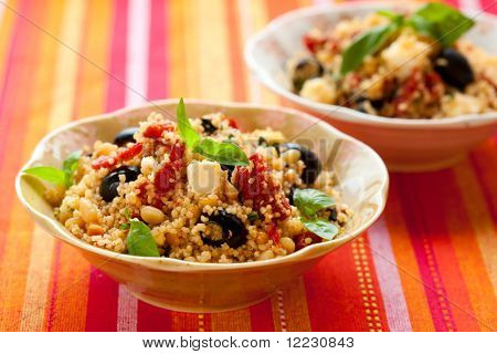 mediterranean couscous salad with dried tomatoes,feta,olives and basil