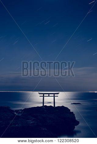 Japanese shinto gate at sea with beautiful moonlight in Oarai Ibaraki prefecture