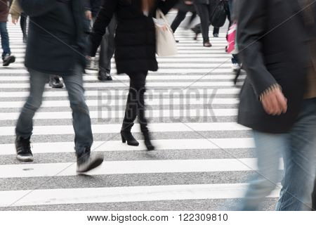 Motion Blurred  People Across Pedestrians At Shibuya Junction, Tokyo, Japan